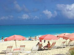 The Ocean Club�s trademark pink umbrellas dot the beach at Grace Bay on Providenciales, Turks and Caicos Islands.