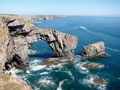 The Green Bridge of Wales, a natural limestone arch, juts out to sea on the Pembrokeshire coast on May 22, 2010. THE CANADIAN PRESS/