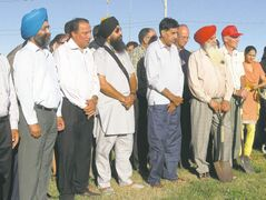 Major Singh Gill (left), of Guru Nanak Darbar Gurdwara, and members of River East Mennonite Brethren Church at garden sod-turning last summer. Both Sikhs and Mennonites promote the value of hard work and sharing to help others.