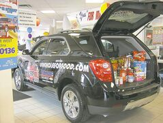 Equinox at Vickar Chevrolet loaded with food for Siloam Mission.
