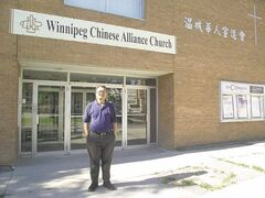 Rev. Deyi Wei stands outside the Winnipeg Chinese Alliance Church where he leads the Mandarin ministry.