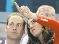 Britain's Prince William, left, and wife Kate, Duke and Duchess of Cambridge watch swimming finals at the Aquatics Centre in the Olympic Park during the 2012 Summer Olympics in London.