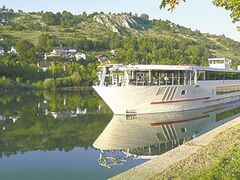 A cruise ship is docked at  Regensburg, Germany.