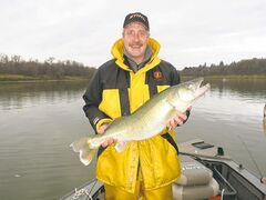 Dan McCrae with a trophy-sized Red River walleye