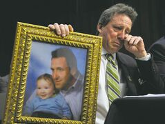 Neil Heslin displays a photo of himself and his late son Jesse, a six-year-old who was one of 19 Grade 1 students slain in the Newtown massacre. Heslin said an assault-weapons ban doesn�t violate the Second Amendment.