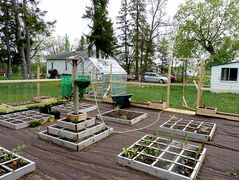 Grow all of the healthy, wholesome vegetables you need in a single season without the backbreaking hours spent weeding in a traditional row garden. This Lockport square-foot garden features numerous 4x4 boxes.
