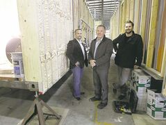 Jeff Olafson, John Kozlowski and John Duerksen (from left) with three large  shipping containers  that are being converted into public washrooms at Assiniboine Park. They hope to have the washrooms open for the Victoria Day long weekend.