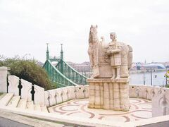 At left, the statue of St. Stephen, Hungary's first king, stands guard in front of Gellert Bath on the Buda bank of the Danube.