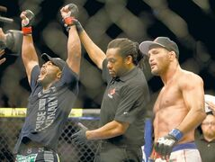 Rashad Evans celebrates his decision win over Dan Henderson at UFC 161 in Winnipeg Saturday.