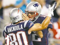 Patriots wide receiver Danny Amendola (left) and QB Tom Brady celebrate a TD reception against the Bucs on Friday.