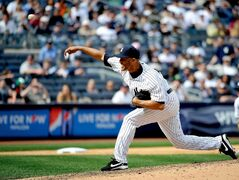 New York Yankees relief pitcher Mariano Rivera closes against the Toronto Blue Jays in the ninth inning of a baseball game at Yankee Stadium, Sunday, April 28, 2013, in New York. The Yankees won 3-2. (AP Photo/Kathy Kmonicek)