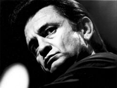 **FILE** In this 1969 file photo, country singer Johnny Cash is photographed at an unknown location. A concert marking the 40th anniversary of Cash's famous concert at Folsom State Prison scheduled for Sunday, Jan. 13, 2008, has been scraped, with the prison and the promoter blaming each other for the cancellation.  (AP Photo, file)
