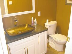 A new vanity with a Japanese-style sink was installed in this bathroom.