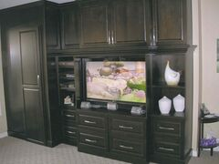 A large entertainment unit was installed in the family room where Ron and Cheryl watch Jets games.