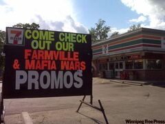A sign outside a 7-Eleven store, in the same neighbourhood where two children were injured in a gang shooting, promotes the online Mafia Wars game.