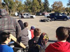 More than more than 200 high school students observe a mock car accident to learn about the dangers of impaired driving.