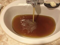 Brown water fills a bathroom sink in a Winnipeg home in the St. John's neighbourhood in September.
