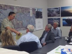 Prime Minister Stephen Harper and Manitoba Premier Greg Selinger are briefed on the flood situation in Brandon by Brian Kayes, the city's emergency coordinator, Sunday afternoon at City Hall.