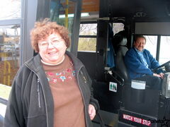 Bernice Shaver boards the bus during a TONS bus tutorial session.