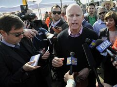 California governor Jerry Brown, second from right, talks to the media about drought concerns during a brief appearance at the World Ag Expo Wednesday morning, Feb. 12, 2014, near Tulare, Calif. Brown railed on lawmakers far off in the nation's capital for fighting that does nothing to bring farmers here any relief. (AP Photo/The Fresno Bee, Eric Paul Zamora) LOCAL PRINT OUT (VISALIA TIMES-DELTA, REEDY EXPONENT, KINGBURG RECORDER, SELMA ENTERPRISE, HANFORD SENTINEL, PORTERVILLE RECORDER, MADERA TRIBUNE, THE BUSINESS JOURANL FRENSO); LOCAL TV OUT (KSEE24, KFSN30, KGE47, KMPH26)