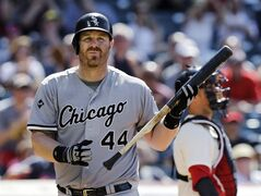 Chicago White Sox's Adam Dunn walks back to the dugout after striking out against Cleveland Indians relief pitcher Cody Allen in the ninth inning of a baseball game Sunday, July 13, 2014, in Cleveland. The Indians won 3-2. (AP Photo/Mark Duncan)