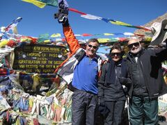 Mohamed Khaki (right) and trekking partner Najma Velshi pose with their guide Bhola Parajuli on top of the Thorong La pass, Nepal in Oct 2010. THE CANADIAN PRESS/Paul Yee