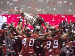 Calgary Stampeders defensive linemen Shawn Lemon (40) and Corey Mace (99) celebrate with teammates after defeating the Hamilton Tiger-Cats in the 102nd Grey Cup in Vancouver, B.C. Sunday, Nov. 30, 2014. The Stampeders have signed Mace to a contract extension. THE CANADIAN PRESS/Paul Chiasson