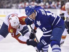 Toronto Maple Leafs' Olli Jokinen (11) faces off against Florida Panthers' Nick Bjugstad (27) during first period NHL action in Toronto on Tuesday, Feb. 17, 2015. The Leafs traded their final pending unrestricted free agent by sending Jokinen to the St. Louis Blues. THE CANADIAN PRESS/Frank Gunn