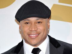 LL Cool J poses backstage at the Grammy Nominations Concert Live! on Friday, Dec. 6, 2013, at the Nokia Theatre L.A. Live in Los Angeles. As host of the Grammy Awards for the third straight year, LL Cool J is supposed to be objective. (Photo by Richard Shotwell/Invision/AP)