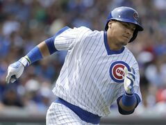 Chicago Cubs' Javier Baez runs to second base after hitting an one-run single during the fifth inning of an interleague baseball game against the Tampa Bay Rays in Chicago, Sunday, Aug. 10, 2014. (AP Photo/Nam Y. Huh)