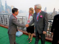 Manitoba Premier Greg Selinger (right), Diane Gray, president and CEO of CentrePort Canada Inc., and Zhang Jianwei, president of Sinotrans and CSC Holdings met in Shanghai to discuss the new trade agreement.
