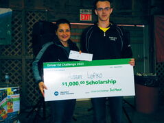 Murdoch MacKay Collegiate student Adam Lefko receives a $1,000 scholarship from Manitoba Public Insurance Driver Education and Training manager Maria Minenna. Lefko, who took his driver education training at Springfield Collegiate, received the award for his third-place showing at the Driver Ed Challenge at the Red River Exhibition Fairgrounds on May 25.