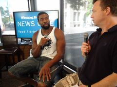 Brandon-raised Chicago Bears star Israel Idonije chats with reporter Geoff Kirbyson in the News Café Saturday morning. Idonije is in town putting on a football camp for underprivileged kids today on behalf of the Israel Idonije Foundation at the University of Manitoba's Investors Group Field.