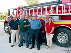 St. Francois Xavier fire chief George Dayton (front row, second from left)  received a Queen Elizabeth II Diamond Jubilee medal last August. Dayton is hoping able-bodied locals will step up to become volunteer firefighters.