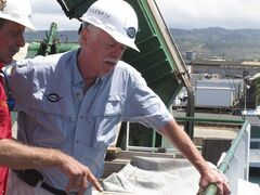FILE - This July 1, 2012 file photo shows Ric Gillespie, right, founder of The International Group for Historic Aircraft Recovery, watching equipment testing alongside Wolfgang Burnside from aboard a ship at port in Honolulu. A federal judge has dismissed a Wyoming man's lawsuit claiming a group secretly found the missing airplane of aviation pioneer Amelia Earhart in the South Pacific but kept it quiet so it could continue to raise funds for the search. (AP Photo/Oskar Garcia, file)