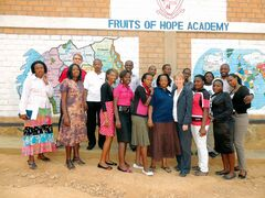 Peter and Evril Hagenlocher are shown with teachers from the Fruits of Hope Academy in Rwanda.