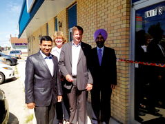 Destination Canada Immigration Solutions immigration consultant Sameer Gupta, Rossmere MLA Erna Braun, Elmwood-Transcona MP Lawrence Toet, and DLC Bay Hill Financial mortgage advisor Gurcharan Singh are shown at the joint grand opening of Destination Canada and DLC Bay Hill offices at 3-933 McLeod Ave. on Aug. 10.