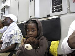 A Haitian child being evacuated on Canadian Forces C-177 Globemaster sits quietly with donated teddy bear prior to flight to Montreal on Tuesday.