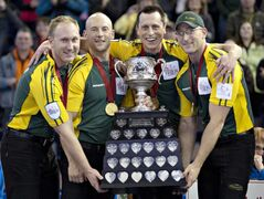 Team Northern Ontario members (from left) Brad Jacobs, Ryan Fry, E.J. Harnden and Ryan Harnden hoist the Brier Tankard after defeating team Manitoba during the championship draw at the Tim Hortons Brier in Edmonton, Alta., Sunday.
