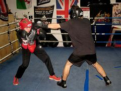 Bryden Travers, 14, slips a punch from Julian Alvarez, 16, at Power Boxing Club. Both boxers will compete in the 2015 Juniors and Youth Canadian National Championships.