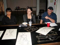 Cloverdale Forge blacksmith Matt Jenkins (right) shows off his sketches for the proposed Centennial community billboard during a community consultation at Frame Arts Warehouse on Thurs., Sept. 4. Also pictured: Adelle Lumanta (left), community connector at Central Neighbourhood Development Corporation (CNDC) and Christa Bishop, community worker at CNDC.