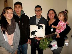 From left: Niomi,13, Faron,15, Jonathan Wong, Michelle, and Julia, 1, in the new home in Centennial. Michelle and her family presented Wong with a thank-you gift.