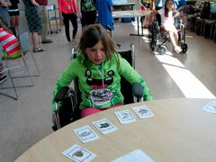 Medical Masters participant Reese Deprez memorizes cards during a wheelchair relay race.