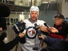 Winnipeg Jets centre Olli Jokinan talks to reporters about the NHL contract talks after practice.