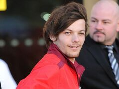 FILE - In this Feb. 26, 2014 file photo, One Direction's Louis Tomlinson arrives at the Keepmoat Stadium, Doncaster, England, Thursday June 19, 2014. A takeover of Doncaster by One Direction singer Louis Tomlinson and former club owner John Ryan has been completed, a spokesman for Ryan confirmed Thursday June 19, 2014. (AP Photo/PA, Anna Gowthorpe, File) UNITED KINGDOM OUT NO SALES NO ARCHIVE