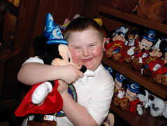 A young participant in a previous Dreams Take Flight trip tightly clutches a Mickey Mouse doll while at Disney World. The Winnipeg chapter of Dreams Take Flight will celebrate 20 years of giving kids one incredible day at Disney World in April 2014.