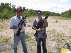 Robert Burkard and his nephew, Jacob Mack, target shooting in Mars Hills.