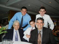 In this July 22, 2011, photo provided by Joseph Vaglio, right, shows his father Pasquale Vaglio, left, his grandchildren Joey Vaglio, center, Michael Franza, top left and Brandon Vaglio on board the Royal Caribbean's