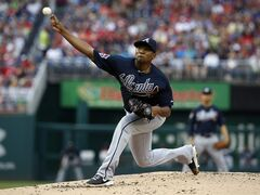Atlanta Braves starting pitcher Julio Teheran throws during the first inning of a baseball game against the Washington Nationals at Nationals Park on Saturday, June 21, 2014, in Washington. (AP Photo/Alex Brandon)