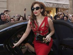 "FILE - In this Monday, Oct. 1, 2012 file photo, Lady Gaga arrives at the Versace atelier in Milan, Italy. Lady Gaga is donating $1 million to the Red Cross to aid those affected by Superstorm Sandy. The New York-born singer posted on her blog Wednesday, Nov. 7, 2012 that she is pledging the money on behalf of her parents and sister. She also said she ""would not be the woman or artist that I am today"" if it weren't for places like the Lower Eastside, Harlem, the Bronx and Brooklyn. She writes:"